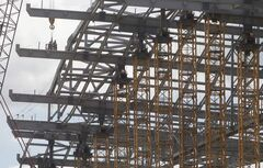 Construction crews work at the new Investors Group Field.
