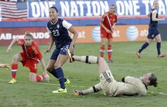 United State's Christen Press (23) smiles after scoring against Russia during an international friendly soccer match in Boca Raton, Fla., Saturday, Feb. 8, 2014. The U.S. won 7-0. (AP Photo/Alan Diaz)