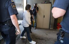 Terri-Lynne McClintic, convicted in the death of 8-year-old Woodstock, Ont., girl Victoria Stafford, is escorted into court in Kitchener, Ont., on Wednesday, September 12, 2012 for her trial in an assault on another inmate while in prison. THE CANADIAN PRESS/ Geoff Robins