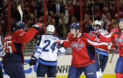 The Washington Capitals' Jason Chimera (right) celebrates his goal with Mathieu Perreault after scoring on the Winnipeg Jets during the first period Tuesday.