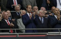 Britain's Prince William, center, applauds before the start of the international friendly soccer match between England and Peru at Wembley Stadium in London, Friday, May 30, 2014. (AP Photo/Matt Dunham)