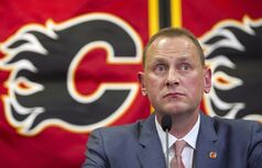 Calgary Flames' new GM Brad Treliving speaks at a press conference in Calgary, Alta., on Monday, April 28, 2014. THE CANADIAN PRESS/Larry MacDougal