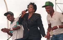 In this Sept. 2, 1995 photo, Fontella Bass dances with Vernon Harris and Curtis Berry on the stage as she sings her 1965 hit