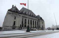 A person walks from the Supreme Court of Canada in Ottawa on Wednesday Feb 27, 2013. THE CANADIAN PRESS/Sean Kilpatrick