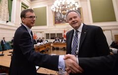 Deputy Governor Tiff Macklem shakes hands as he and Bank of Canada governor Stephen Poloz appear at a Commons finance committee on Parliament Hill in Ottawa on Tuesday, April 29, 2014. THE CANADIAN PRESS/Sean Kilpatrick