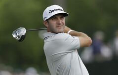 Dustin Johnson watches his tee shot on the second hole during the second round of the PGA Colonial golf tournament in Fort Worth, Texas, Friday, May 23, 2014. (AP Photo/LM Otero)