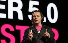 T-Mobile CEO John Legere speaks at T-Mobile's Uncarrier 5.0 event, Wednesday, June 18, 2014, in Seattle. (AP Photo/Ted S. Warren)