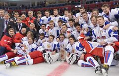 Members of Team Russia pose for a photograph during victory ceremonies following the bronze medal hockey game at the IIHF World Junior Championships in Ufa, Russia, on Saturday, Jan. 5, 2013. Russia beat Canada 6-5 in overtime to win the bronze medal. THE CANADIAN PRESS/Nathan Denette