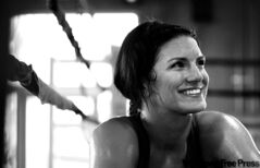 Gina Carano may be the pretty face of mixed martial arts, but she's not about to cover up her bruises and black eyes.