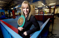 WBC super featherweight champion Olivia Gerula with her title belt at GoJoe's gym in North Winnipeg.