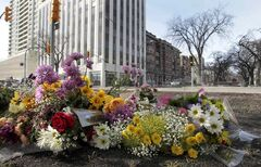 A flower memorial lies on Broadway Avenue and Donald Street Wednesday morning for Amy Gilbert, who was fatally injured at the intersection when she was struck by a car on Saturday.