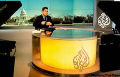 Anchor Shihab Rattansi starts news program at Al-Jazeera studio in Washington.
