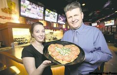 Caitlyn Fecyk and Andrew Shefchyk of Boston Pizza have noticed an increase in visits as of late.