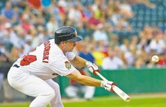 Goldeyes David Narodowski lays down a sacrifice bunt to advance a runner to second base on Wednesday, July 4 at Shaw Park.