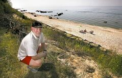 Tom Rathwell knows his beachfront property at VIctoria Beach will take time to sell. About three metres of his yard disappeared during the 2010 weather bomb.