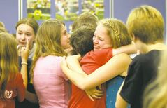 Students share last-day-of-school hugs. Most of them will be together again next year at Glenlawn Collegiate, but two plan to attend other high schools.