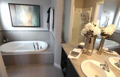 The ensuite bath has a heated tile floor and a jetted soaker tub.