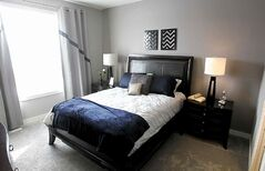 The master suite features a big picture window and walk-in closet.