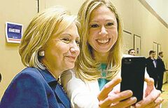 This June 14, 2013 photo released by Barbara Kinney shows former Secretary of State Hillary Rodham Clinton, left, posing with her daughter Chelsea at a Clinton Global Initiative America event in Chicago. The practice of freezing and sharing our tiniest slices of life in