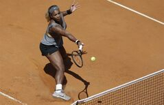Serena williams returns the ball to Italy's Sara Errani during their final match at the Italian Open tennis tournament, in Rome, Sunday, May 18, 2014. Serena Williams kept the crowd from being a factor in a 6-3, 6-0 victory over 10th-seeded Sara Errani to win the Italian Open for the third time Sunday. (AP Photo/Andrew Medichini)
