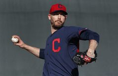 Cleveland Indians pitcher John Axford throws during spring training baseball practice in Goodyear, Ariz., Thursday, Feb. 13, 2014. (AP Photo/Paul Sancya)
