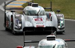 The Audi R18 e-tron quattro driven by Italy's Marco Bonanomi, Portugal's Filipe Albuquerque and Britain's Oliver Jarvis in action during the 82nd 24-hour Le Mans endurance race, in Le Mans, western France, Saturday, June 14, 2014. (AP Photo/Bob Edme)