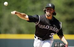 Colorado Rockies starting pitcher Christian Bergman works against the Miami Marlins in the first inning of a baseball game in Denver on Sunday, Aug. 24, 2014. (AP Photo/David Zalubowski)
