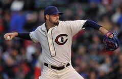 Chicago Cubs starter Jason Hammel delivers a pitch during the first inning of baseball game against the St. Louis Cardinals in Chicago, Sunday, May 4, 2014. (AP Photo/Paul Beaty)