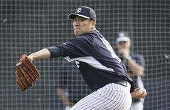 New York Yankees starting pitcher Masahiro Tanaka throws a pitch during spring training baseball practice Friday, Feb. 21, 2014, in Tampa, Fla. (AP Photo/Charlie Neibergall)