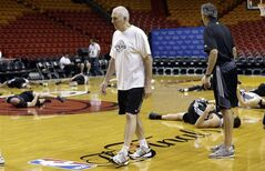 San Antonio Spurs head coach Gregg Popovich, left, watches as players stretch during basketball practice at the NBA Finals, Wednesday, June 11, 2014, in Miami. The Spurs lead the Miami Heat 2-1 in the best-of-seven games series. (AP Photo/Lynne Sladky)