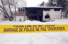 Police tape surrounds the scene of a fatal house fire ripped through a Ross Avenue home, late on Friday night. Three people managed to escape  the blaze but one person died of smoke inhalation.