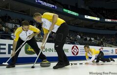 Manitoba's Jeff Stoughton and sweepers Reid Carruthers (left) and Steve Gould brushed aside NWT Tuesday morning in front of several interested fans.