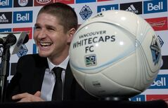 Carl Robinson attends a news conference in Vancouver, Monday, Dec.16, 2013 where he was announced as the new head coach of the Vancouver Whitecaps MLS team. THE CANADIAN PRESS/Jonathan Hayward