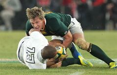 FILE - A Saturday, June 16, 2012 photo from files showing South Africa's captain Jean de Villiers, right, as he tackles England's Jonathan Joseph, left, during their Rugby Test match at Ellis Park stadium in Johannesburg, South Africa. Springboks captain Jean de Villiers will miss games against a World XV, Wales and Scotland next month with a knee injury that is expected to sideline him for eight weeks. The South African Rugby Union said de Villiers had a medical procedure Sunday to discover the extent of the problem in his left knee after he felt discomfort on Saturday and was withdrawn from a Super Rugby game for his Cape Town-based Stormers team. (AP Photo/Themba Hadebe, File)