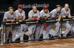Members of the Cincinnati Reds watch from the dugout in the ninth inning of an interleague baseball game against the Baltimore Orioles, Wednesday, Sept. 3, 2014, in Baltimore. Baltimore won 5-4. (AP Photo/Patrick Semansky)