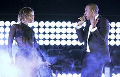 FILE - This Jan. 26, 2014 file photo shows Beyonce, left, and Jay Z performing