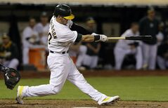 Oakland Athletics' Josh Donaldson hits a three-run home run off of Detroit Tigers pitcher Joe Nathan during the ninth inning of a baseball game in Oakland, Calif., Wednesday, May 28, 2014. The Athletics won 3-1. (AP Photo/Jeff Chiu)