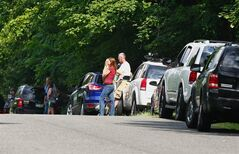 Fans and media gather in front of LeBron James' home Thursday, July 10, 2014 in Bath Township, Ohio, awaiting his announcement of where he will play next season. (AP Photo/Akron Beacon Journal, Karen Schiely) MANDATORY CREDIT
