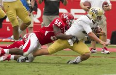 Marcus McGraw (55) of Houston, seen here tackling UCLA quarterback Richard Brehaut (12), will join the Blue Bombers' practice roster.