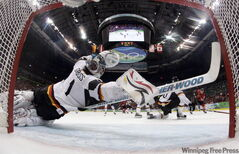 Germany goalie Thomas Greiss stretches to block a shot against Canada in the third period.
