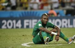 Ivory Coast's Serey Die sits on the pitch after Greece's 2-1 victory over Ivory Coast during the group C World Cup soccer match between Greece and Ivory Coast at the Arena Castelao in Fortaleza, Brazil, Tuesday, June 24, 2014. (AP Photo/Christophe Ena)