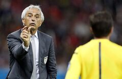 Algeria's head coach Vahid Halilhodzic gestures to the assistant referee during the World Cup round of 16 soccer match between Germany and Algeria at the Estadio Beira-Rio in Porto Alegre, Brazil, Monday, June 30, 2014. (AP Photo/Frank Augstein)