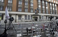 Ladders from various media organisations are seen lined up as policemen stand guard outside the King Edward VII hospital where Kate Duchess of Cambridge is receiving treatment in central London, Wednesday, Dec. 5, 2012. Prince William and his wife Kate are expecting their first child, and the Duchess of Cambridge has been admitted to hospital suffering from a severe form of morning sickness in the early stages of her pregnancy. (AP Photo/Alastair Grant)