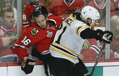 Chicago Blackhawks center Marcus Kruger collides with Boston Bruins defenseman Andrew Ference in the third period during Game 2 of the NHL hockey Stanley Cup Finals, Saturday, June 15, 2013, in Chicago. THE CANADIAN PRESS/AP, Charles Rex Arbogast