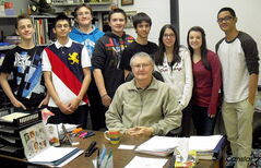 St. Boniface Diocesan High School students flank retiring teacher Steve Boyko. From left to right: Leif Gudmundson, Ramzi Otaki, Paul Gocik, Dominic Gocik, Damien Dragne, Monica Cabral, Domenica Burroughs, J.P. Austria.