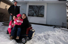 Sonya Chesworth and husband William Anderson, with daughters Illyria, 6, and Juliette, 2, in their Talbot Avenue home. They bought it under the Manitoba Real Estate Association's Manitoba Tipi Mitawa program.