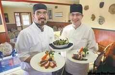 Chef Matthew Yuen (left) and sous chef Bjorn Nelson do some of the city's best cooking at Cafe Dario.