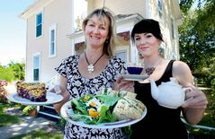 Leanne Stewart, left, with chicken salad sandwich and saskatoon crumble, while Chelsey Frank pours a cuppa tea.
