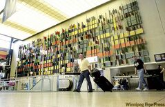 Art by John Graham on the north wall of the airport terminal complements the mid-20th-century building.