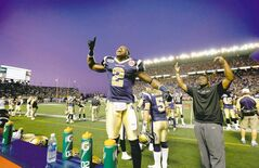 Jovon Johnson (2) responds  to the fans as the Bombers  beat the Edmonton Eskimos  August 5, 2011.